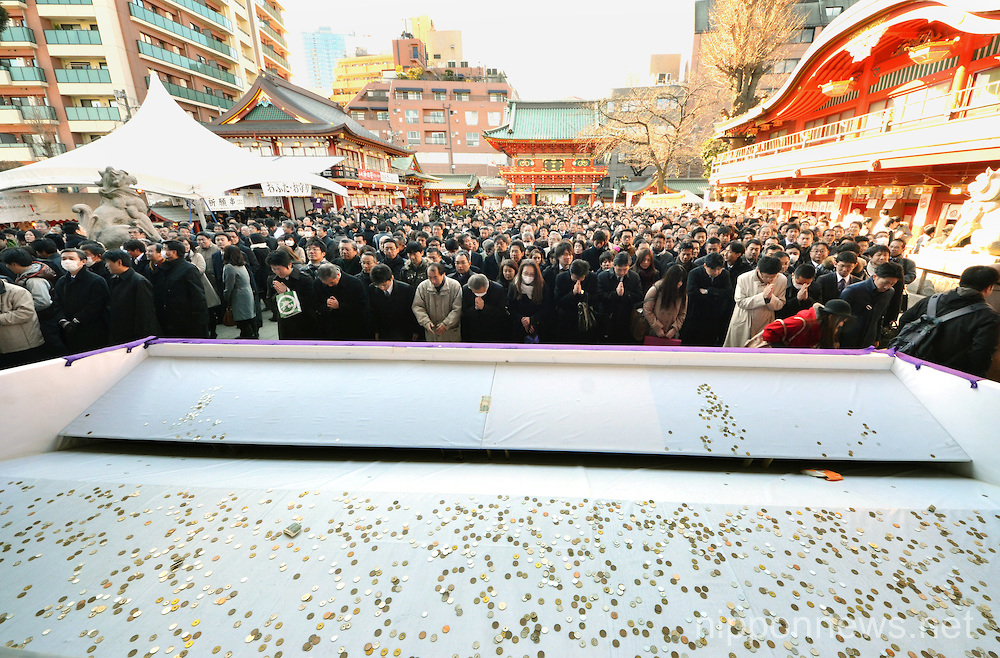 Japanese businessmen praying for thriving business at Tokyo's Kanda Myojin