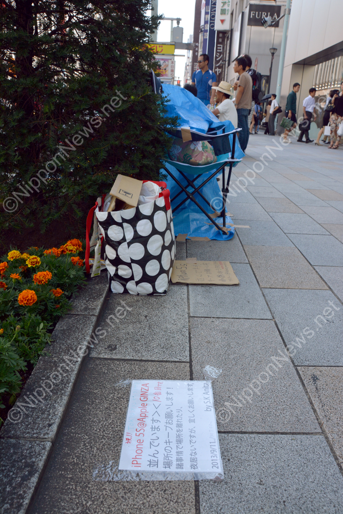 People camping outside the Ginza Apple Store in Tokyo to get the new iPhone5