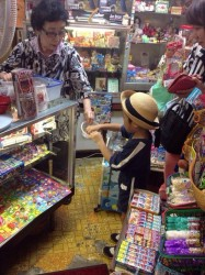 A kid at the candy shop