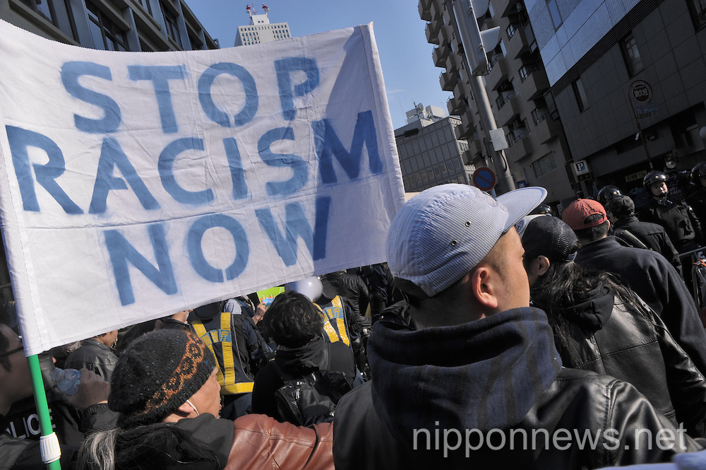 Anti-racist demonstrate against far right march in Tokyo