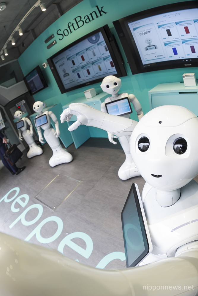 SoftBank Japan opens a phone store staffed entirely by robots in the upmarket Omotesando shopping area on March 24, 2016, Tokyo, Japan. A team of 10 humanoid Pepper robots run the Pepper Phone Shop serving customers buying SoftBank mobile phones. The store is a world first exclusively staffed by robots and will be open until March 30. (Photo by Rodrigo Reyes Marin/AFLO)