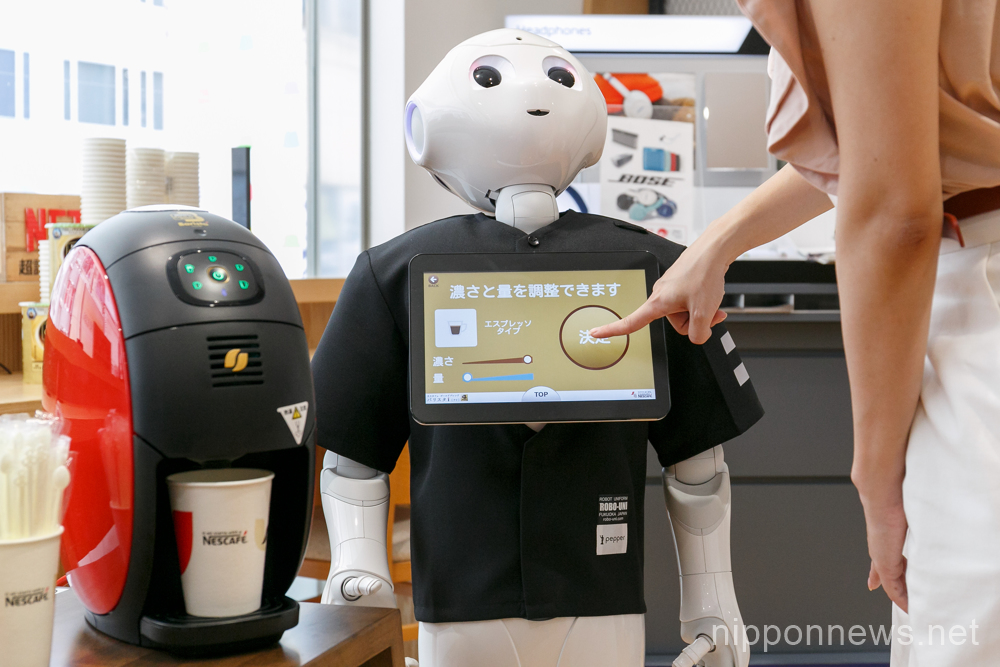 Robot Pepper starts to work serving coffee at SoftBank store
