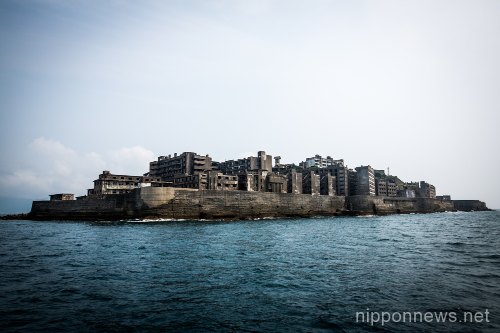"Tourists visit the abandoned island of Gunkanjima or ""Battleship Island"""