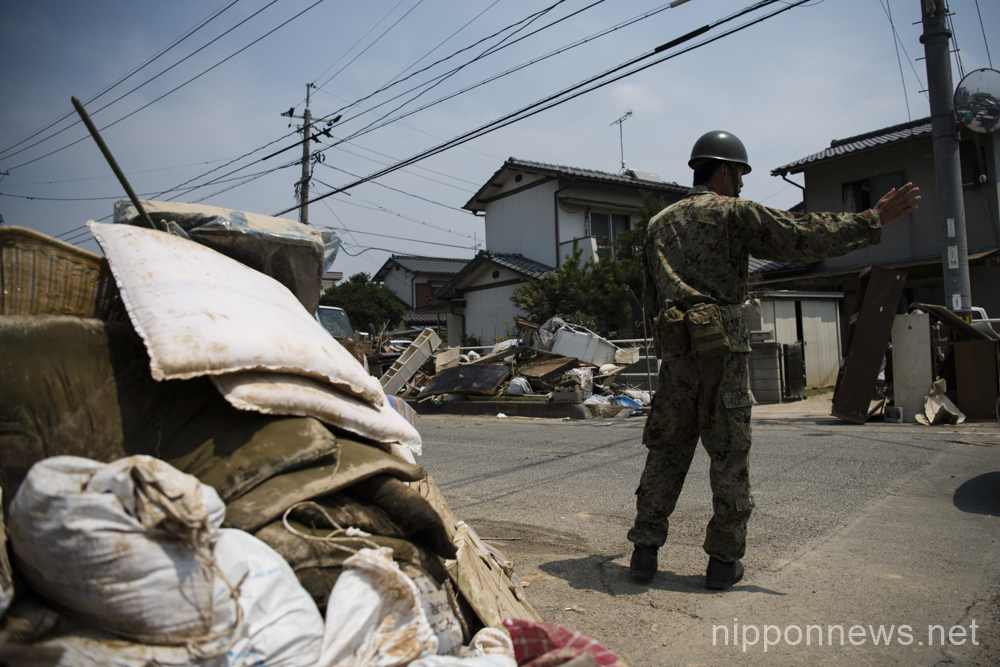 Cleaning and recovery efforts continue in heat after flood disaster in Okayama