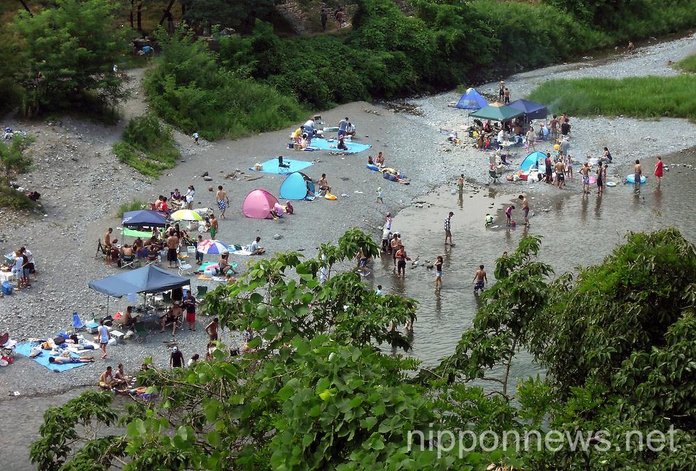 Japanese Enjoy River Recreation During Summer