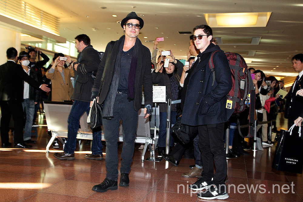 Brad Pitt and Logan Lerman Arrive in Japan