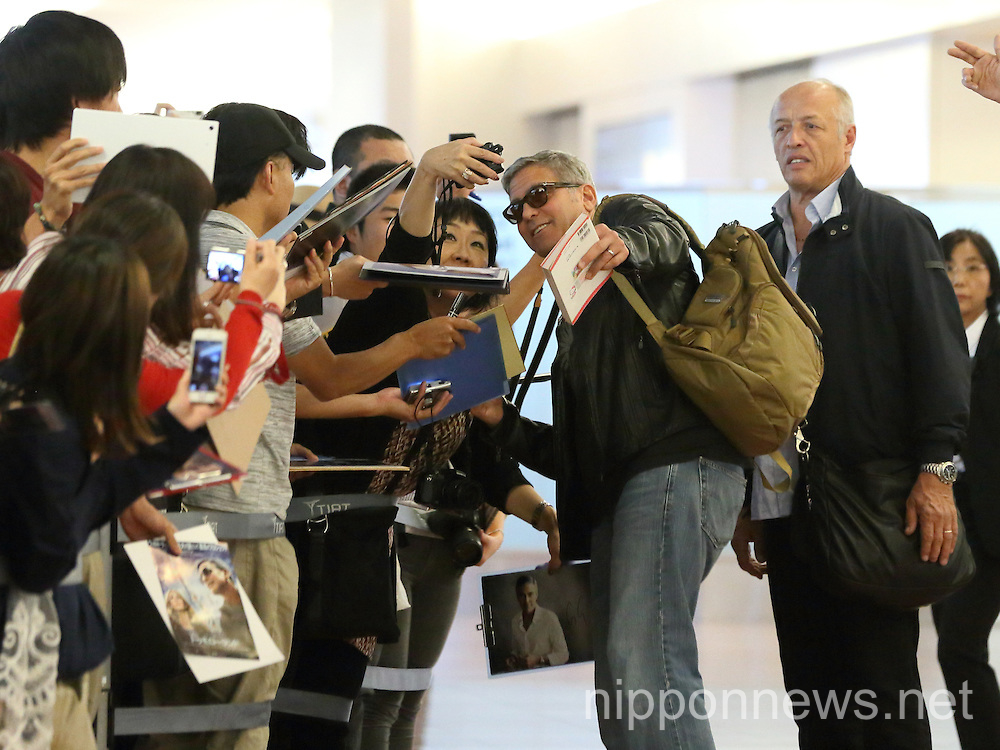 George Clooney and wife Amal arrive at Haneda Airport in Japan