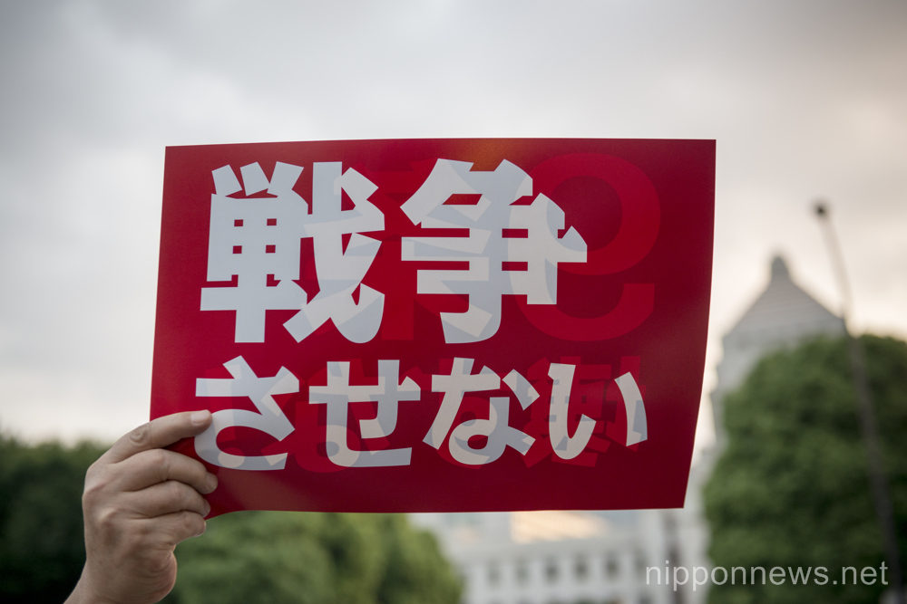 Japanese gather outside parliament to protest against suggested changes to the constitution on June 24, 2015 in Tokyo, Japan. As Japanese parliament debates changing the interpretation of Article 9 of the constitution public opinion is strengthening against Prime Minister Abe and every Friday demonstrations are organised. On June 24th some 2000 people gathered to oppose any changes and to call for peace. (Photo by Alessandro Di Ciommo/AFLO)