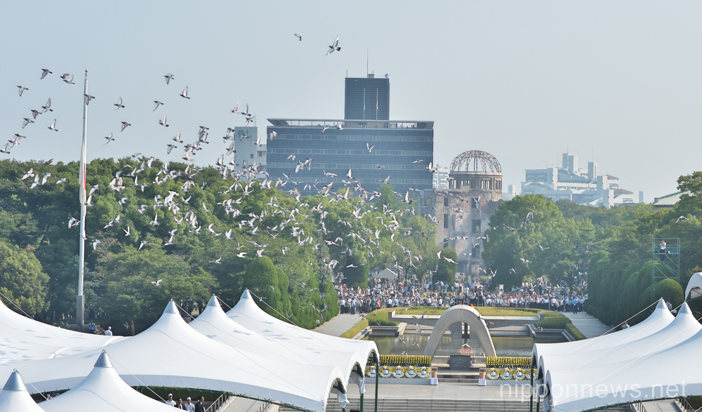 August 6, 2015, Hiroshima, Japan : Released doves fly during the 70th memorial ceremony of the atomic bombing at Hiroshima Peace Memorial Park in Hiroshima, Japan on August 6, 2015. (Photo by AFLO)
