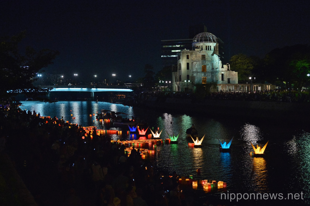 August 6, 2015, Hiroshima, Japan : People float colorful paper lanterns with message into the Motoyasu River in front of the Atomic Bomb Dome marking the 70th anniversary of the atomic bombing in Hiroshima, Japan, on August 6, 2015.