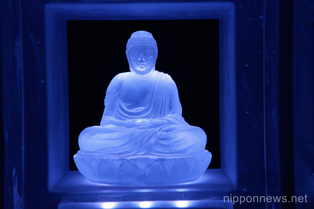 High tech Tokyo cemetery with LED Buddhas