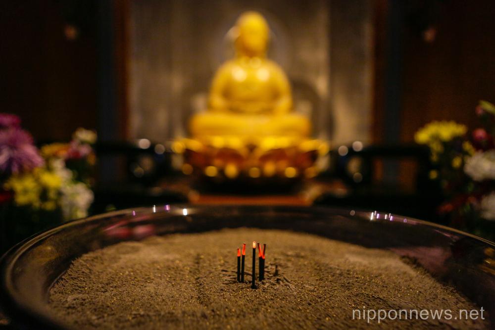 High tech Tokyo cemetry uses crystal LED Buddha statues