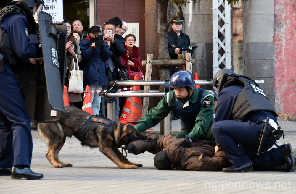Armed police conduct mock security drill at Shinbashi station in Tokyo