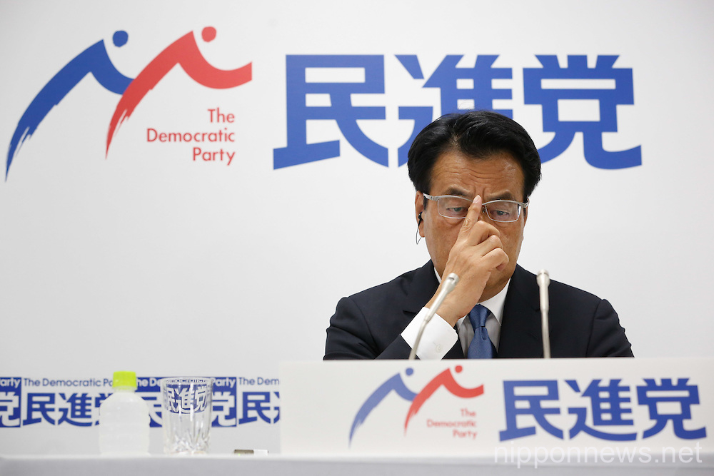 Leader of Japan's main opposition Democratic Party Katsuya Okada reacts about Upper House election results
