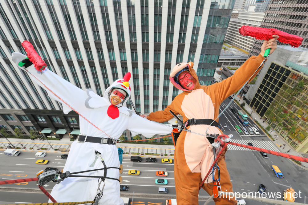 Monkey and rooster clean hotel windows for New Year