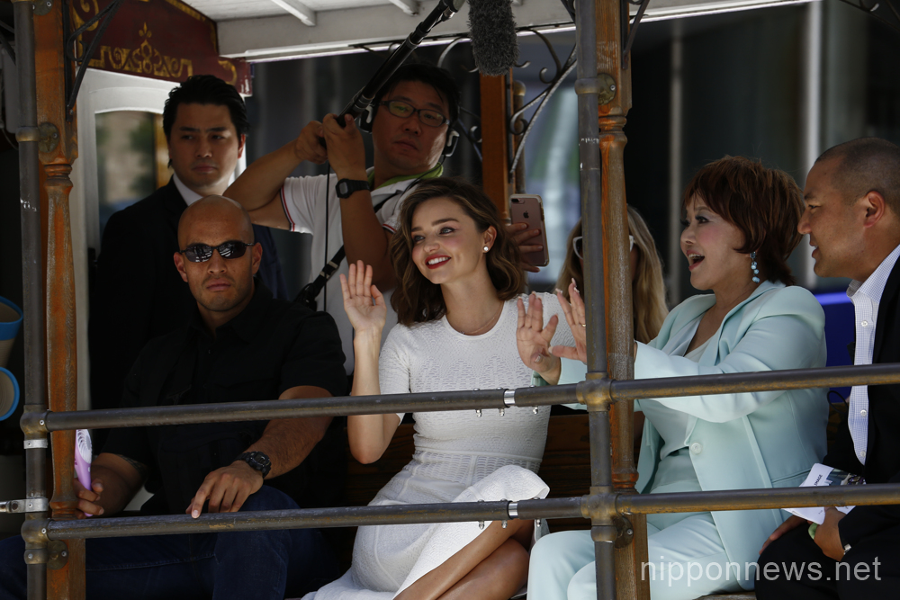 Miranda Kerr rides campaign bus through Tokyo shopping district