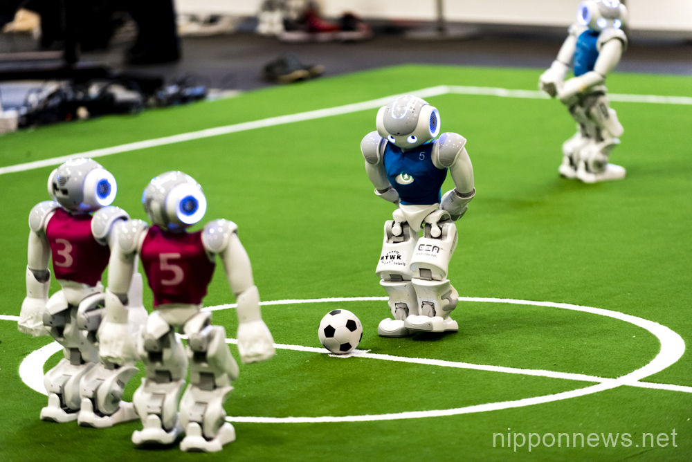 Humanoid robots show off their skills during RoboCup soccer