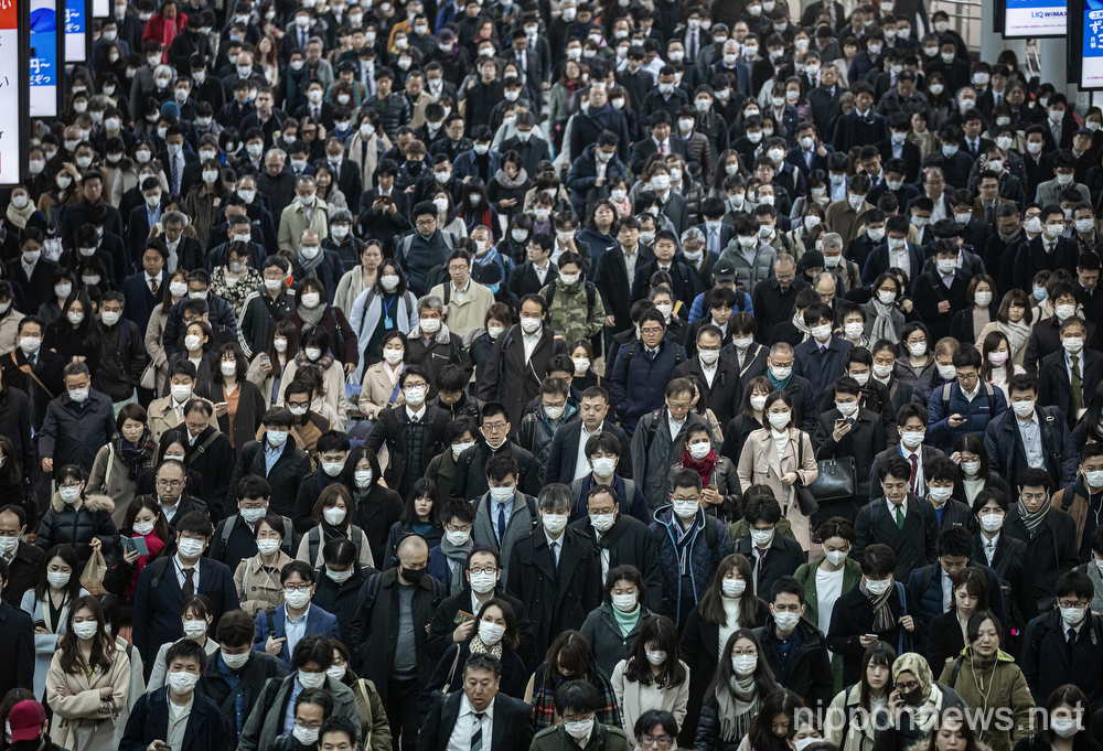 Japanese workers commuting wearing face masks